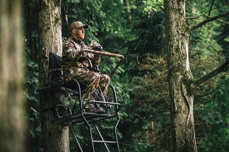 A man hunting in a tree