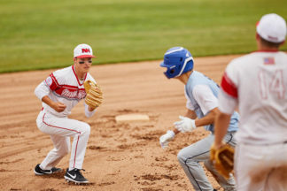 Three baseball players during a play