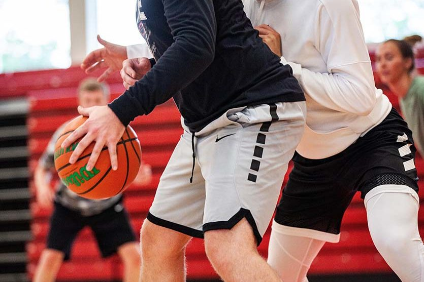 A group plays basketball.