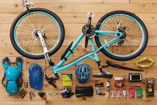 teal bike with bike laydown with bike accessories