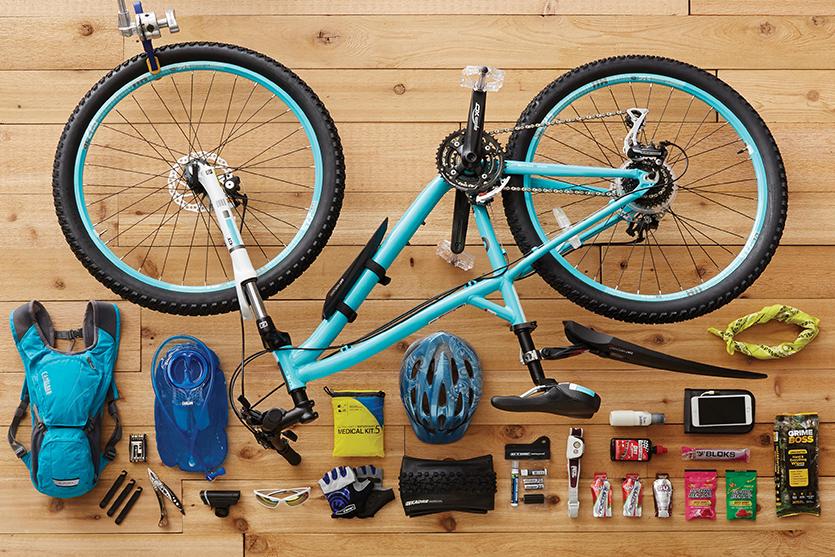teal bike with bike laydown with bike accessories