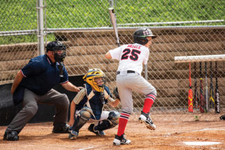 young baseball player at bat with ideal batting stance