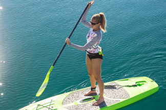 woman on stand up paddleboard with a personal flotation device