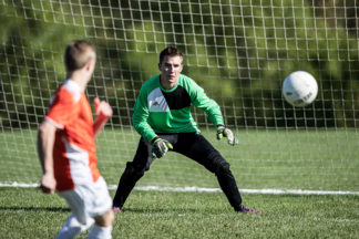 Soccer goalie prepares for save