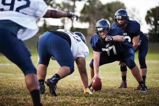 football center grips ball before snap