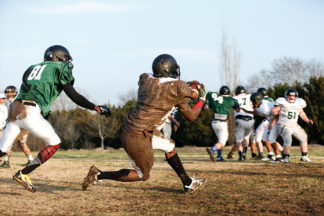 Football linebacker zone covers a receiver in the mud