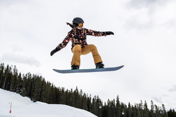 Female snowboarder shows off her stance