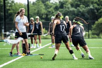 Lacrosse coach oversees practice