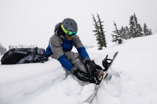 Man sits and prepares for the slopes