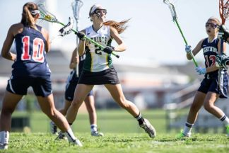 A lacrosse player prepares to make a pass during a game.