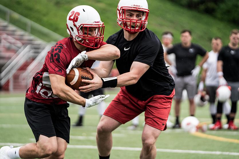 Football quarterback handoff to running back