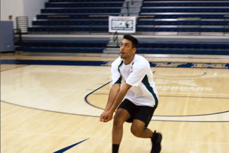 male volleyball player creating a strong platform