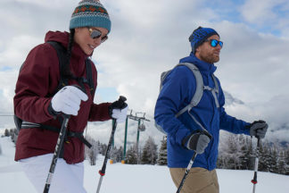 man and woman snowshoeing wearing The North Face