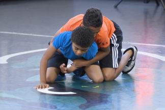 Two young wrestlers show how to do a chop and bump breakdown.
