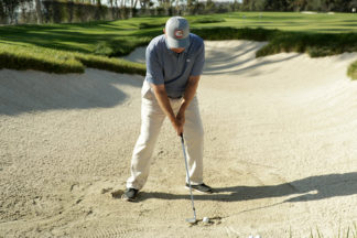 Roger Cleveland hitting out of a bunker