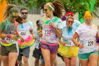group of girls running in a fun run or color run