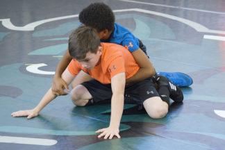 Two young wrestlers show how to build a base.