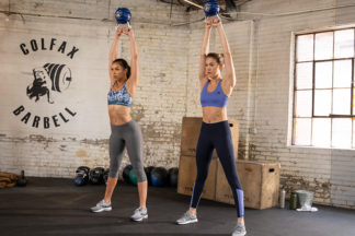 two women doing kettlebell exercises