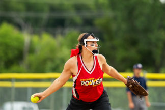 softball pitcher gripping a curveball