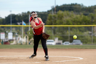 softball pitcher throwing pitch finish