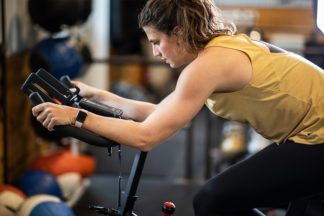 woman at the gym on exercise bike