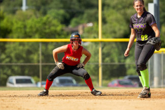 softball player taking baserunning lead