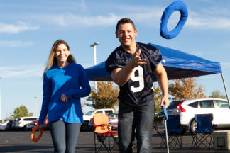 two people playing hooking halos at a tailgate