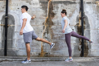 male and female doing pre-run stretches