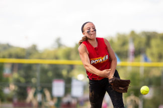 softball pitcher throwing a screwball