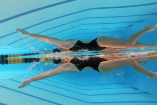go pro photo of girl doing the backstroke