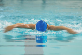 woman swimming the butterfly stroke