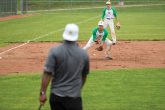 Baseball Player Fielding Ground Ball