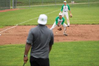 Baseball Player Fielding Ground Ball
