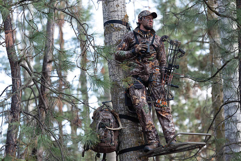guy in camo in a treestand