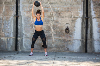 woman using slam ball