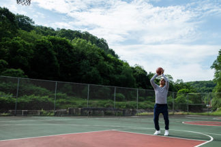 Basketball Player Shooting Free Throw On Outdoor Court
