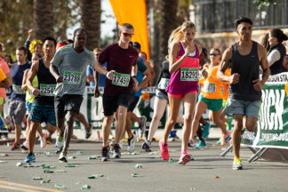 group of marathon runners running a race