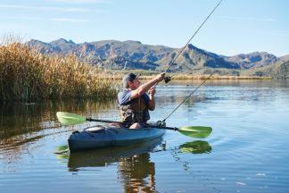Man In Fishing Kayak