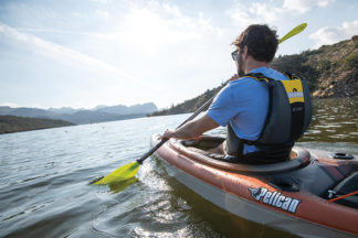 Man Paddling In Kayak
