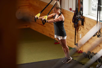 Woman Using Suspension Trainer