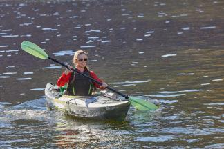 Kayaker Paddling On Water