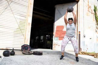 Woman Slamming Medicine Ball
