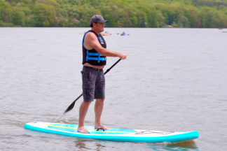 Man Paddling On Inflatable Stand Up Paddleboard
