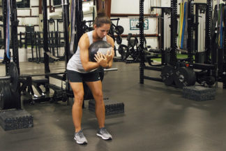 Woman Doing Hip-Hinge With Medicine Ball