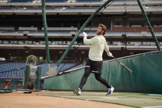 Professional Baseball Player Bryce Harper Taking Swing In Batting Practice