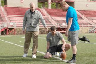Football Player Preparing To Kick Ball