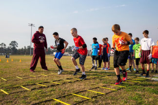 Football Players Using Agility Ladders