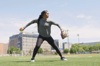 Professional Softball Player Aleshia Ocasio Throwing a Softball