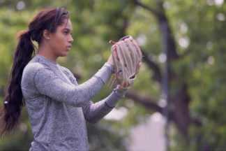 Professional Softball Player Aleshia Ocasio Preparing To Throw Pitch