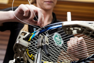 DICK'S Sporting Goods Service PRO restringing a tennis racquet